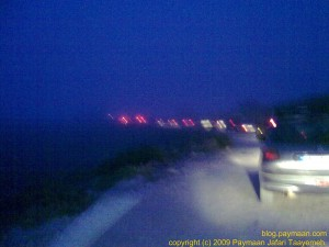 Line of cars waiting to enter the protected area and get permissions, Fog everywhere.